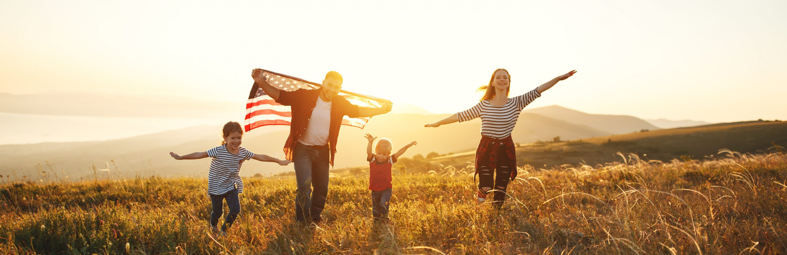 Family running with American flag